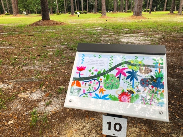 Participants follow the large, colorful story book pages throughout the park in Story Walk Thomasville.