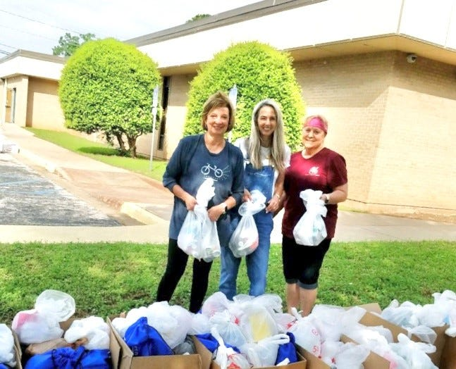 Senior Junior Forum members recently assisted in the delivery of emergency boxes to Meals on Wheels clients. From left to right: Vicki Tigert, Christy Whiteley and Colleen James.