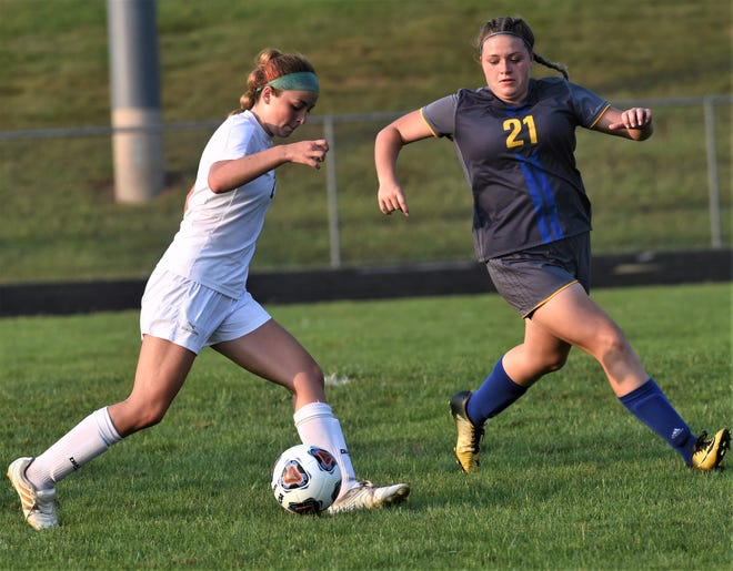 River View's Cadie Guilliams tries to dribble past Philo's Zoe Wilhelm during Wednesday's match at The Philo Athletic Complex. River View won 4-2.