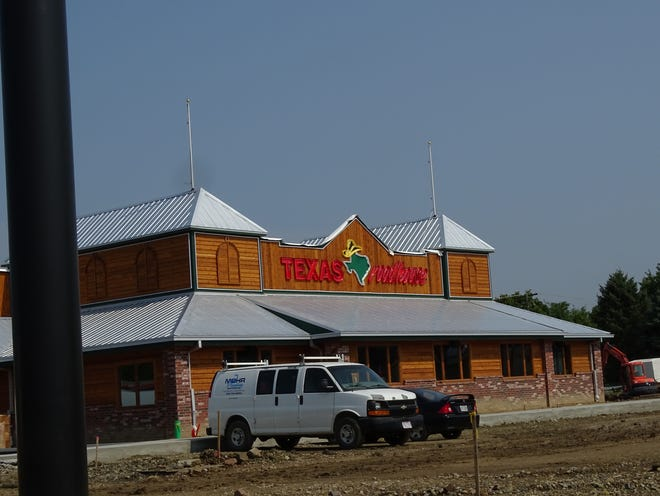 Developers are putting finishing touches on the new Texas Roadhouse location at 365 Zane St. before its Oct. 12 opening.