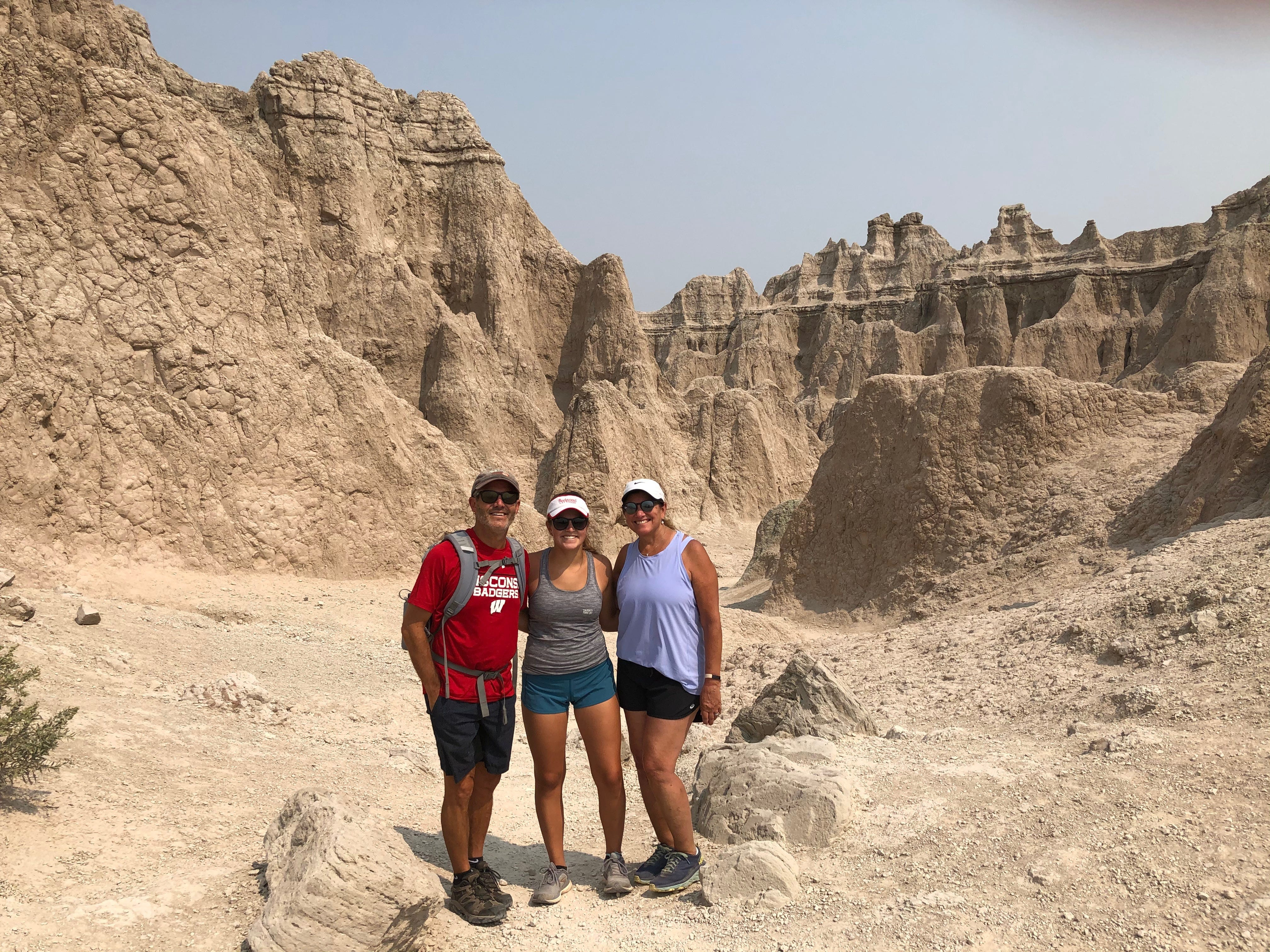 (From left) Scott, Lindsay and Laurie Dubin pose for a picture at Badlands National Park on their road trip to UW-Madison.