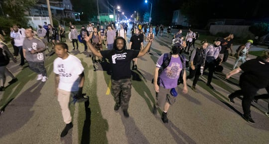 """About 600 people chanting """"Black live matter"""" march peacefully Wednesday, August 26, 2020 near downtown in Kenosha, Wis. Violent unrest broke out after video of the shooting of Jacob Blake, 29, was widely disseminated on social media Sunday. Blake was shot in the back several times by a Kenosha police officer and left paralyzed."""