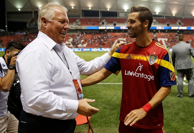 Real Salt Lake owner Dell Loy Hansen (left) shown celebrating with with forward Sebastian Jaimein 2015.