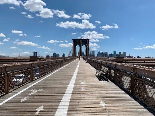 Walking across the Brooklyn Bridge on July 14.