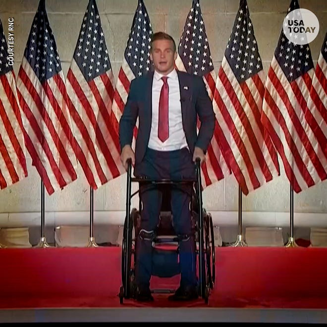 At the end of his speech at the Republican National Convention, 11th Congressional District candidate Madison Cawthorn, who is paralyzed from the waist down, stood with the assistance of a walker and leg braces.