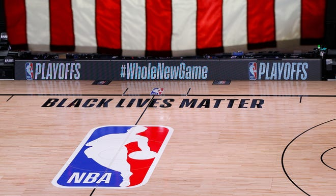 An empty court and bench is shown following the scheduled start time of Game 5 between the Bucks and Magic.