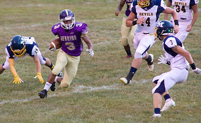 Elijah Frederick of Sebring, shown in an earlier game, rushed for over 100 yards and intercepted a pass for the Trojans in Friday's Mahoning Valley Athletic Conference game against Lowellville.