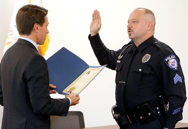 Mayor Matt Miller swears in Ashland Police Department's Jonathan Kohler as a sergeant on Friday.