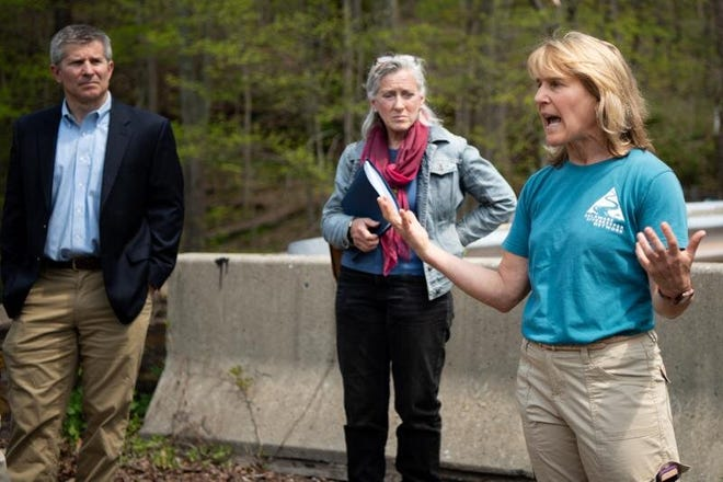 Delaware Riverkeeper director Maya van Rossum stands at the site of Headquarters Road Bridge in Tinicum Township in 2018, urging elected officials to direct PennDOT toward a viable plan to reopen the historic one-lane bridge.