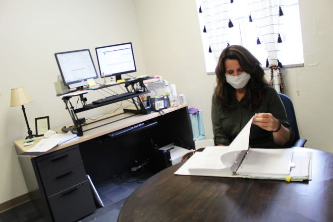 School guidance counselor Marsha Fouts works in her office after a meeting with colleagues. Kim Archer/Examiner-Enterprise