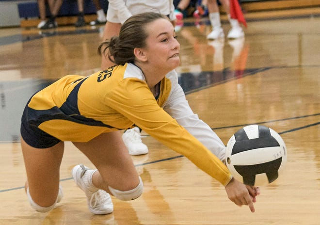 Action like this — Eustis' Victoria Schultz diving for the ball during a 2019 match last year against Lake Minneola — may soon be filling gyms as high schools sports moves cautiously closer to its seemingly inevitable start. [PAUL RYAN / CORRESPONDENT]