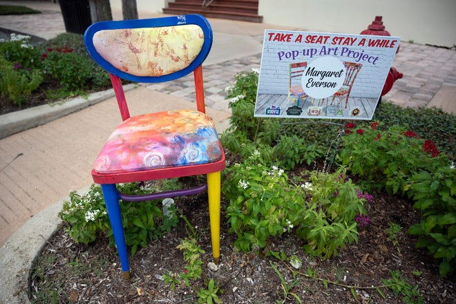 """Chair art is displayed on a Main Street corner in downtown Leesburg as part of the """"Take a Seat and Stay a While"""" pop-up art project by the Leesburg Center for the Arts. [Cindy Peterson / Correspondent]"""