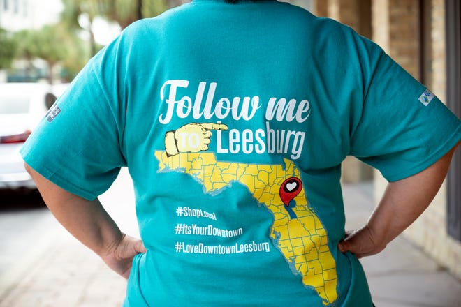"""T-shirts are $20 and come in green or gray, and the back features their slogan, """"follow me to Leesburg,"""" with the state of Florida and a marker where Leesburg is. [Cindy Peterson/Correspondent]"""