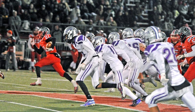 Orrville's Marquael Parks busting one of his signature big runs against Triway.