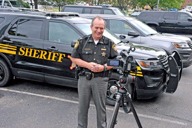 Capt. Doug Hunter, of the Wayne County Sheriff's Office, records one of his daily update videos, which are posted on the agency's Facebook page in an effort to keep the community informed.