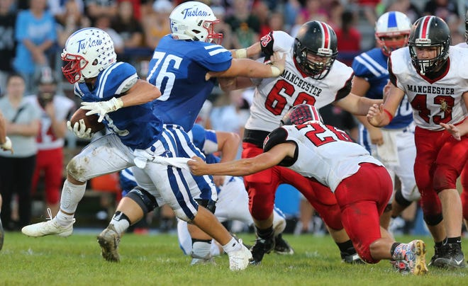 Tuslaw's Aaron Swogger (76) blocks for now-departed running back Brier Marthey.