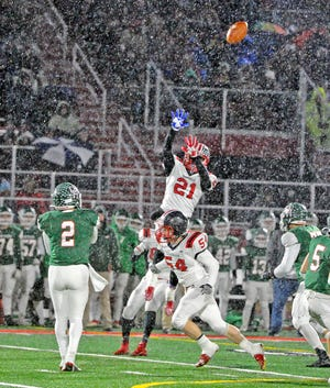 Orrville's Marquael Parks (21) and Jacob Bailey (54).