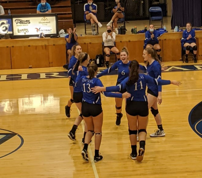 Central Christian celebrates after scoring a point in a straight-sets win over Dalton.
