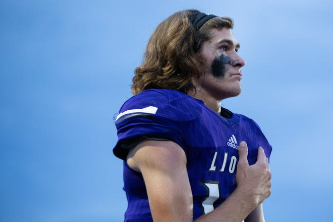 Columbia Central High School quarterback Brady McCanless (18) stands for the National Anthem before the first home game of the season against Dickson County High School in Columbia, Tenn., on Thursday, Aug. 27, 2020.