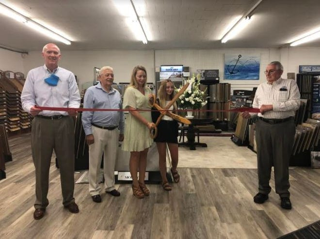 The Lexington Area Chamber of Commerce participated in a 40-year anniversary ribbon-cutting ceremony on Aug. 26 for Creative Carpets and Discount Sales, 600 Martin Luther King Jr. Blvd. Pictured standing left to right are Lexington Chamber President Joe Wallace, previous owner Frank Polston, current owner JoAnn Kelly, Teagan Kelly and Davidson County Commissioner Fred McClure.