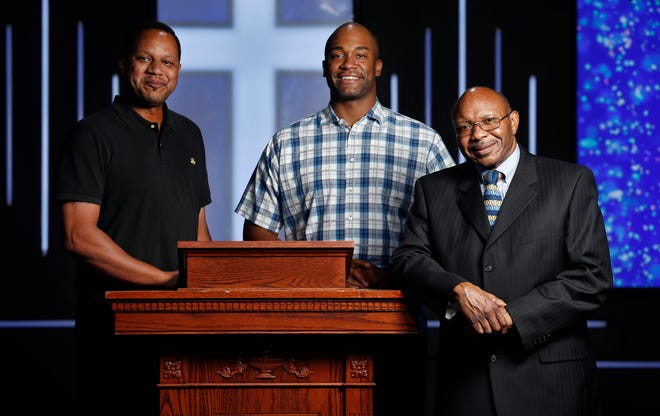 Pastor Chris Simmons (right) is pictured at the lectern with program director Donald Wesson (center) and Ernest Baylor at Cornerstone Baptist Church in Dallas, Wednesday, Aug. 19, 2020. For more than 30 years, Pastor Simmons has ministered to the congregation of Cornerstone Baptist Church, with Donald Wesson, who oversees its community ministries/resources arms, at his side for the last eight years.