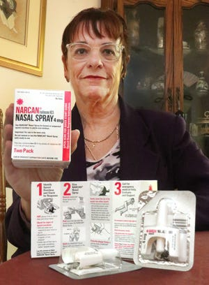 Karen Chrapek, board president of Volusia Recovery Alliance, holds a Narcan Nasal Spray kit, Wednesday August 26, 2020.