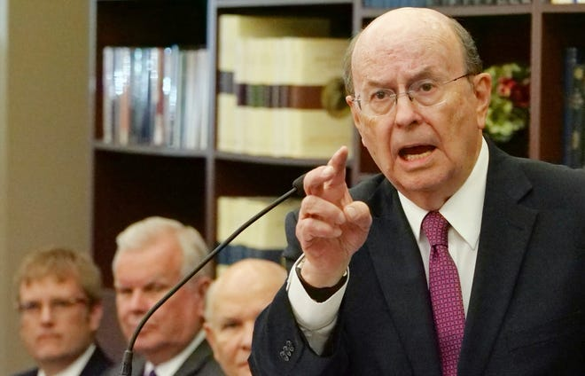 In this Sept. 4, 2018, file photo, Quentin L. Cook, right, a high-ranking leader from The Church of Jesus Christ of Latter-day Saints, speaks during a news conference in Salt Lake City.