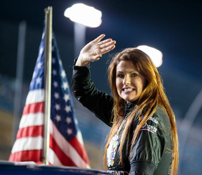 NASCAR Camping World Truck Series driver Jennifer Jo Cobb, a Kansas City area native, waves to the crowd before a race at Homestead-Miami Speedway.