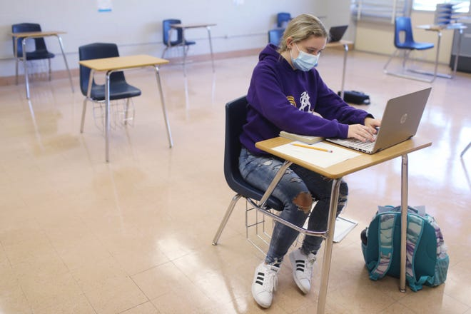 Daniele Ebert, 15, a sophomore works on a summer school english lesson in a classroom in the former James Madison Middle School building Aug. 20 in Burlington.