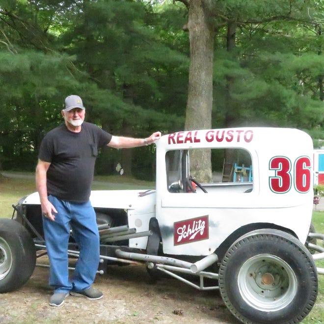 Bob Lane of Burlington, a 1996 inductee into the 34 Raceway Hall of Fame, stands in front of his Schlitz wagon super modifed car that he used to drive. Lane raced for parts of seven decades.