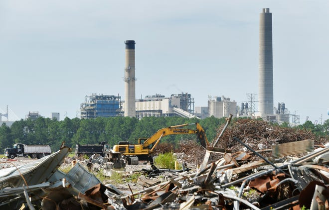 The metal debris from the demolished St. Johns River Power Park electric generating station is being removed from the site so it can be positioned for some new kind of development. The Northside Generating Station, shown in the background, still is a workhorse for JEA's electric needs, but the old power park site could be redeveloped in a way that dovetails with the nearby Blount Island marine terminal on the St. Johns River.