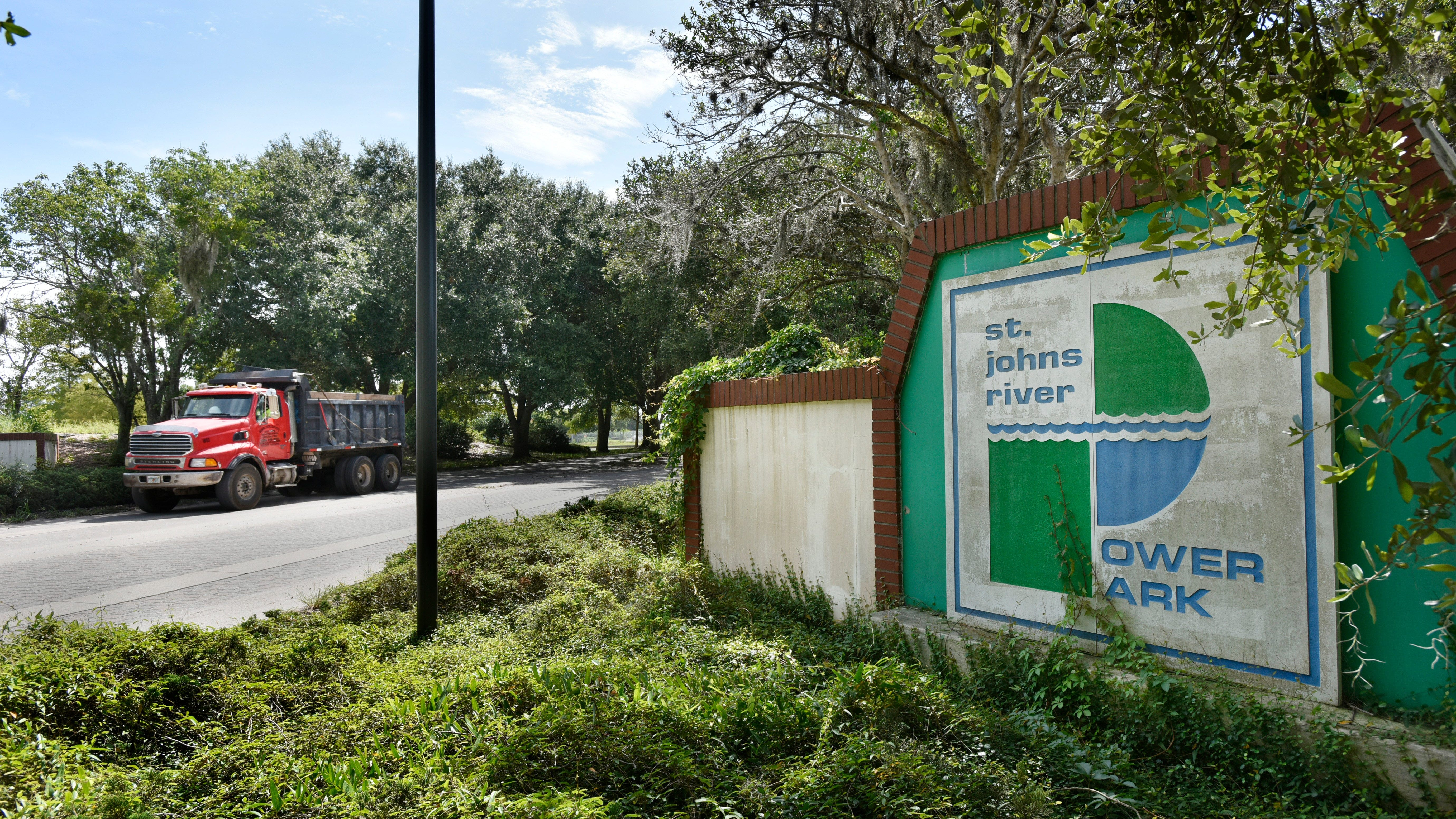 A dump truck carrying debris from the demolished electric plant at the St. Johns River Power Park exits the property onto New Berlin Road. While removal of removal of debris  will continue through the fall, JEA will seek a partner for bringing in a new kind of development to 1,200 acres owned by the utility.
