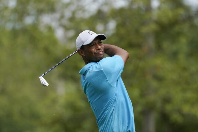 Tiger Woods hits from the 12th tee during the first round of the BMW Championship golf tournament, Thursday, Aug. 27, 2020, at Olympia Fields Country Club in Olympia Fields, Ill. (AP Photo/Charles Rex Arbogast)