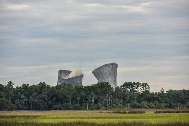 The twin cooling towers at the St. Johns River Power Park adjacent to the Northside Generating Station are brought down with more than 1,500 pounds of on June 16, 2018. JEA wants to bring new job-creating development to the site and JaxPort is interested in the property.