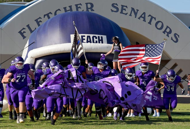 Fletcher football players run onto the field for a 2019 game against Sandalwood. Duval County Public Schools confirmed Friday that capacity at fall sports would be capped at 30 percent. [Bob Mack/For The Times-Union]