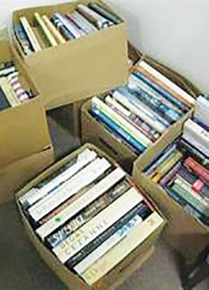 Boxes of books at an earlier Clinton Public Library sale.