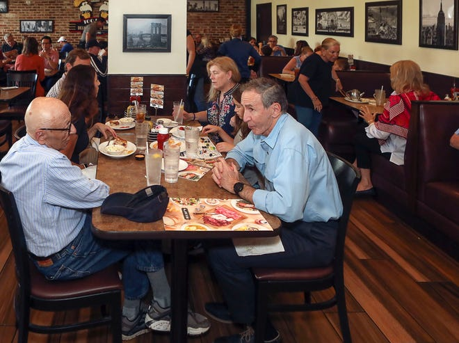 Diners enjoy lunch at Toojay's in the Royal Poinciana Plaza.