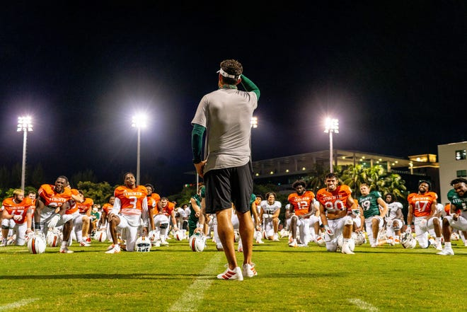 Miami coach Manny Diaz talks to team. [Tim Brogdon/Miami Athletics]