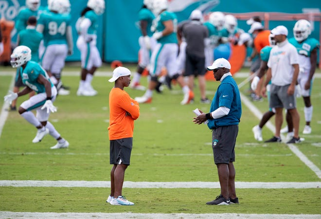 Miami Dolphins head coach Brian Flores (right) at Miami Dolphins training camp August 28, 2020.  [ALLEN EYESTONE/The Palm Beach Post]