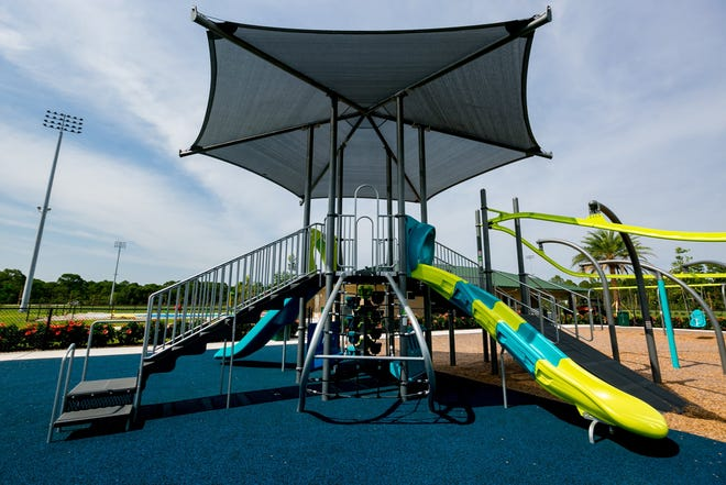 A playground inside The Gardens North County District Park in Palm Beach Gardens has reopened following a five-month closure amid the novel coronavirus pandemic. City staff will be disinfecting all playgrounds once a day. [Palm Beach Post file photo]