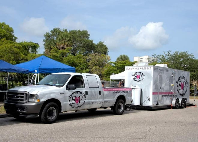 Streets of Paradise used this trailer to provide showers for the homeless in Sarasota.