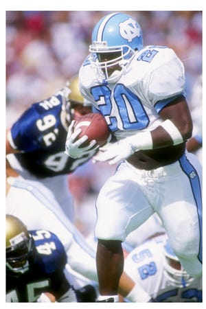 Natrone Means, who compiled 3,074 yards rushing and 34 touchdowns in three seasons at UNC in 1990-92 and went on to play seven seasons in the NFL with a Super Bowl appearance, has been hired as assistant head coach, offensive coordinator and running backs coach at Fayetteville State.