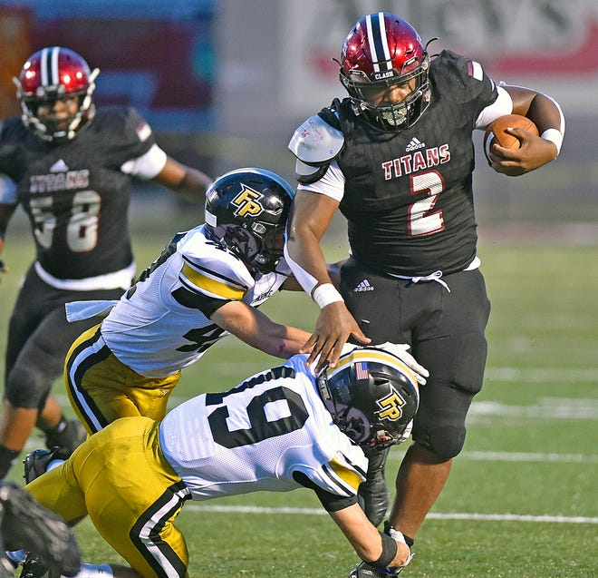 Gadsden City's CJ Miller tries to shake the tackle of Ft. Payne's Caden Holbrook on August 27.