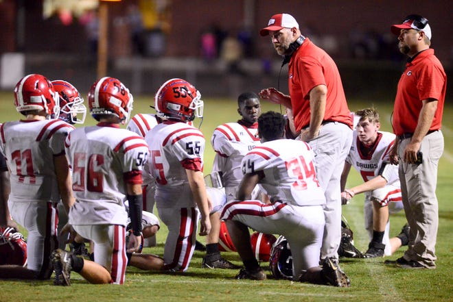 Gaston head coach Matt Harris talks to his Aug. 27 during a timeout in a game against Coosa Christian.
