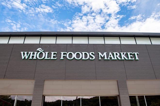 "The sign on the building that was once an Earth Fare at 1856ÊHendersonville Road has officially been changed to ""Whole Foods Market"" but the opening date for the new grocery store is still unknown. Photographed Aug. 28, 2020."
