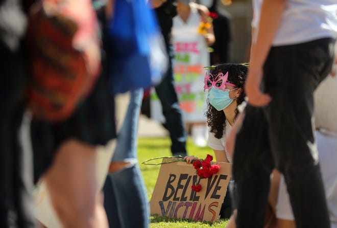"""Students, alumni, parents and teachers gathered at the Central Kitsap Administration Building in Silverdale to protest """"rape culture"""" in Central Kitsap schools on Friday."""