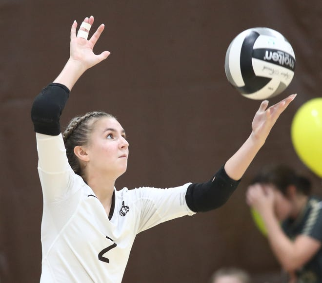 Roger Bacon's Cammy Niesen serves during their volleyball game against Kettering Alter, Thursday, Aug. 27, 2020.