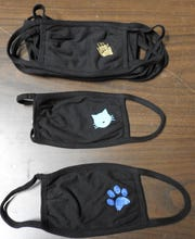 Face masks with sparkling logos are being sold at $5 apiece as a fundraiser for the Coshocton County Humane Society. They are made by Designs by Michele. Money is needed for medical, food and more to take care of cats.
