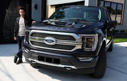 Josh Henry, a senior designer for the exterior of the 2021 Ford F-150 with the pickup truck at his Ferndale, Michigan home on August 27, 2020. Henry took up the challenge of designing his home when he wasn't doing design work on the popular pickup truck.