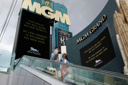 """The MGM Grand hotel-casino, which is closing, flashes messages on their marquees that read """"Your health and well-being are our priority. We look forward to welcoming you back soon."""" Monday, March 16, 2020, in Las Vegas."""